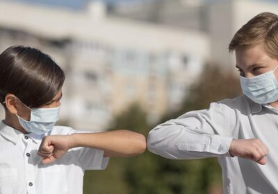 front-view-kids-greeting-with-elbow-bump
