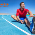 Selective Focus Of Soccer Player Holding Football Boot While Sit
