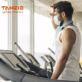 side-view-man-with-medical-mask-treadmill.jpg